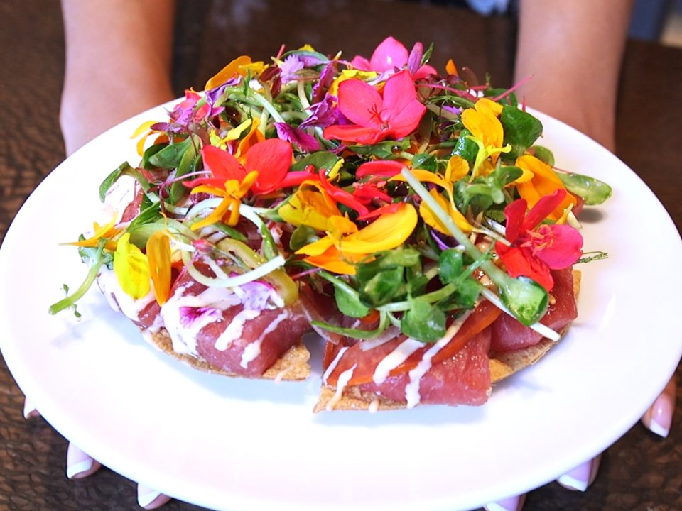 Sashimi pizza with edible flowers