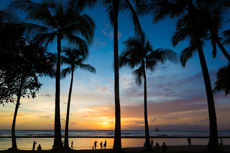 Watch the sunset on Waikiki Beach