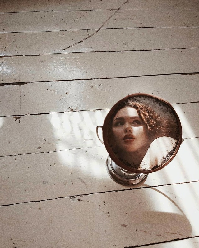 Rosey image in an antique mirror