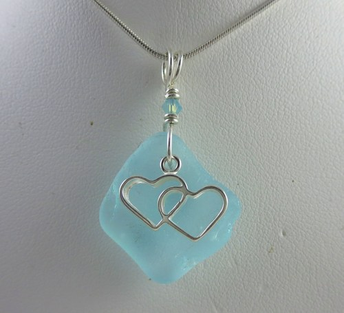 Two hearts as one pendant neckalce