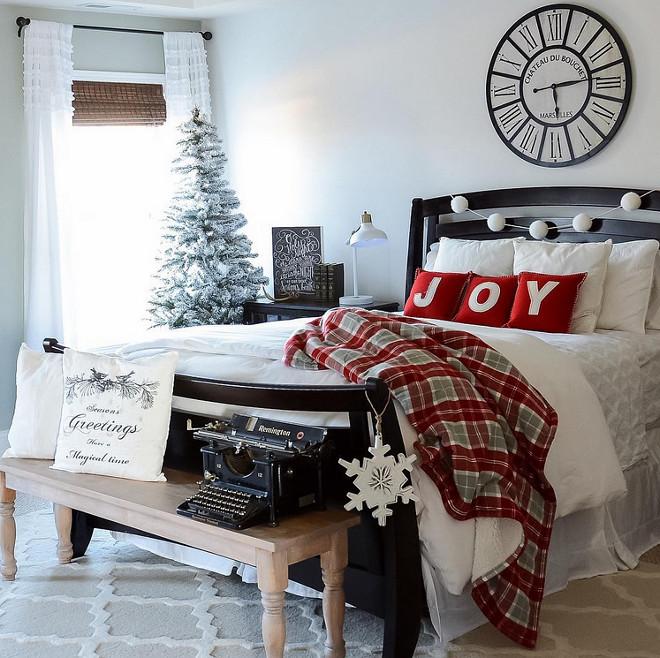 Plaid blanket on snow white bedding