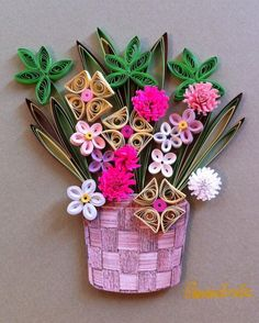 Quilling. flowers in a basket